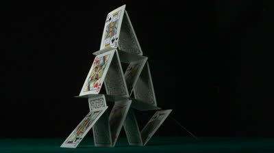 stock-footage-pyramid-house-of-playing-cards-falling-down-shooting-with-high-speed-camera-phantom-flex